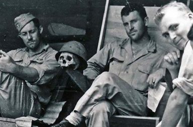American pilots resting with a Japanese skull, 1944
