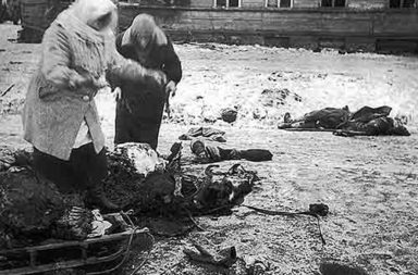 Two women collect the remains of a dead horse for food, Siege of Leningrad, 1941.