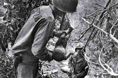 US Marine discovers a near-dead baby in a cave in the jungle of Saipan island, 1944