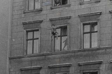 Four-year-old Michael Finder of East Germany is tossed by his father into a net held by firemen across the border in West Berlin, 1961
