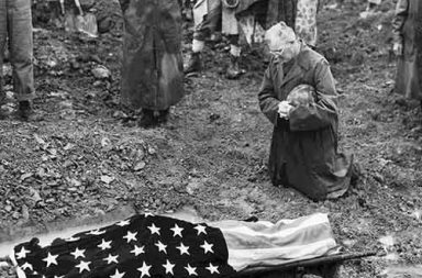 US Marine Colonel Francis Fenton conducting the funeral of his son Private First Class Mike Fenton, Okinawa, 1945