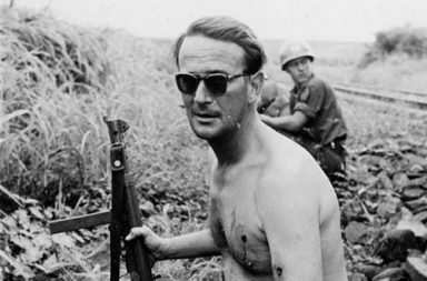 Swedish Major Eric Bonde smokes a cigarette after being ambushed and shot twice, Congo, 1961