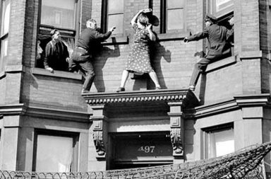 A lady battles with police as they try to prevent her from committing suicide, 1942