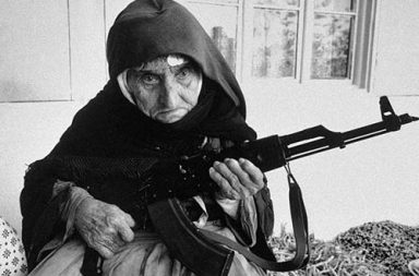 A 106-year old Armenian woman protecting her home with an AKM, 1990